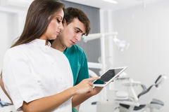 Dentists with tablet Royalty Free Stock Photography
