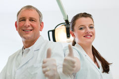 Dentists in their surgery Stock Photography