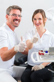 Dentists in their surgery or office Stock Photos