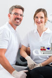 Dentists in their surgery or office with dental tools Stock Image