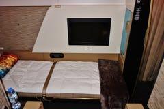 Dentro da série da primeira classe no andar superior de um Airbus A380 de Etihad Airways EY Fotos de Stock