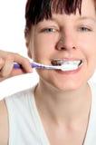 Dents de brossage Image stock