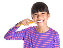 Dents de brossage de jeune fille VI Image stock