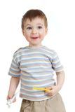 Dents de nettoyage de chéri et sourire sur le blanc images libres de droits