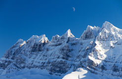 Dents du midi moon. Beautiful mountains of the Dents du midi in the European Alps with the moon above them Stock Image