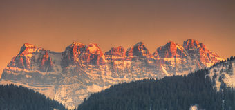 Dents du Midi. Sunset over the pics on Dents du Midi situated in the Chablais Alps in the Swiss canton of Valais Stock Photos