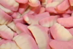 Dents roses et blanches de confiserie photo stock