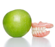 Denture and apple Stock Images