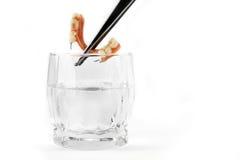 Denture being extracted with tweezers Stock Images