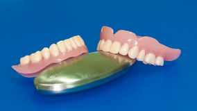 Denture on a blue background Stock Photography