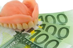 Denture and euro bills Stock Photos