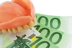 Denture and euro bills Royalty Free Stock Image