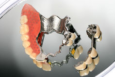 Denture on mirror Stock Photo
