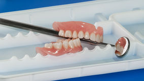 Denture on tray with mirror Stock Images