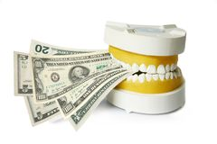 Dentures biting dollar banknotes clipart, Royalty Free Stock Images