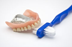 Dentures with brush Stock Photography