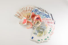 Dentures and cash Royalty Free Stock Images