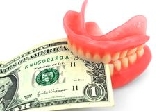 Dentures and dollar Royalty Free Stock Photos