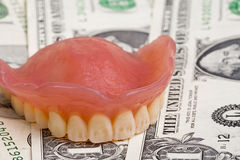 dentures on dollars Royalty Free Stock Images