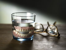 Dentures in a glass of water Stock Image
