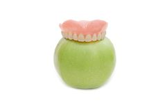 Dentures with green apple Stock Images