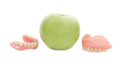 Dentures with green apple Royalty Free Stock Images