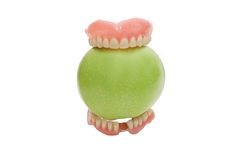Dentures with green apple, isolated Royalty Free Stock Photography