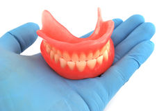 Dentures in hand Stock Photography
