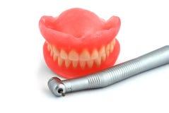 Dentures and handpiece Stock Images