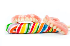 Dentures with lollipops Stock Photos