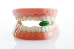 Dentures made of sugar and white chocolate with tablet Royalty Free Stock Image