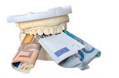 Dentures and money Royalty Free Stock Image