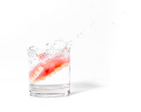 Dentures splash and falling drop into glass of water Royalty Free Stock Photography