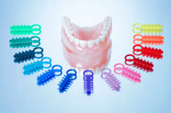 Dentures surrounded by ligature ties royalty free stock photos