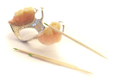 Dentures and toothpicks Royalty Free Stock Image