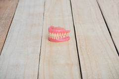 Dentures on wooden table Royalty Free Stock Photography
