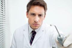 Dentysty mienia wody opryskiwania narzędzie Zdjęcie Royalty Free