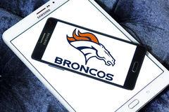 Denver Broncos american football team logo. Logo of Denver Broncos american football team on samsung mobile. The Denver Broncos are an American football team stock photo