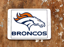 Denver Broncos american football team logo. Logo of Denver Broncos american football team on samsung tablet on wooden background. The Denver Broncos are an stock photos