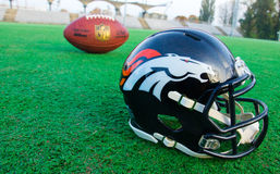 Denver broncos helmet and ball Royalty Free Stock Image