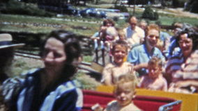 DENVER, COLORADO 1951: Family riding Elitch Gardens classic train ride. Unique vintage 8mm film home movie professionally cleaned and captured in 4k (3840x2160 stock footage