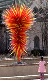 Denver Botanic Gardens. A girl looking at the glass sculpture on a free admission day. stock images