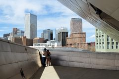 A couple taking pictures on the deck with a view on Denver downtown cityscape stock photos