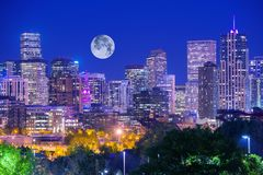 Denver Colorado at Night. Denver Downtown Skyline and the Full Moon on Clear Sky Stock Image