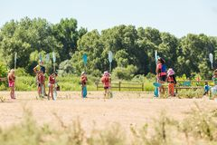 Kids summer camp. Denver, Colorado, USA-July 13, 2016. Summer kids advanture camp preparing for canoeing royalty free stock photography