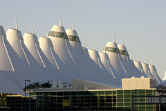 Denver International Airport. At dawn with sunlight hitting peaks Stock Images