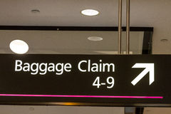 Denver International Airport. Baggage claim directional sign at airport Stock Image