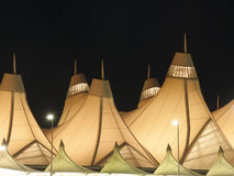 Denver International Airport at Night. At Denver International Airport, the Jeppesen Terminal's internationally recognized peaked roof, designed by Fentress Royalty Free Stock Photography