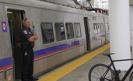 Denver light rail. Security personnel standing by the train Stock Photo