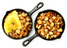 Denver Omelette and Ranch Potatoes in Cast Iron Skillet Isolated Royalty Free Stock Image